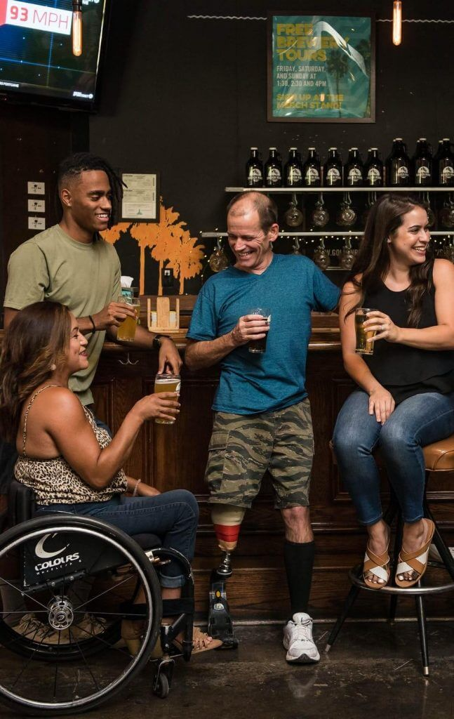 Image of people enjoying a beer out at a restaurant during restaurant week.