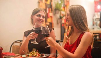 Image of people enjoying a wine out at a restaurant during restaurant week.