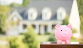 Budgeting-to-Buy-or-Sell-a-Home-with-Money-Piggy-Bank